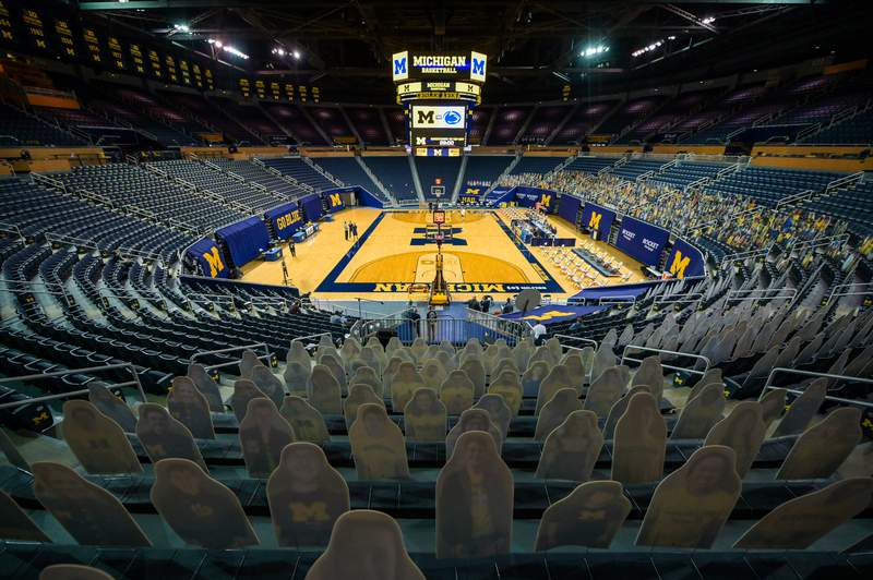 Michigan Wolverine cardboard fan cutouts are shown before a college basketball game against the Penn State Nittany Lions at Crisler Arena on December 13, 2020 in Ann Arbor, Michigan. Fans are not allowed in the arena due to the COVID-19 pandemic.