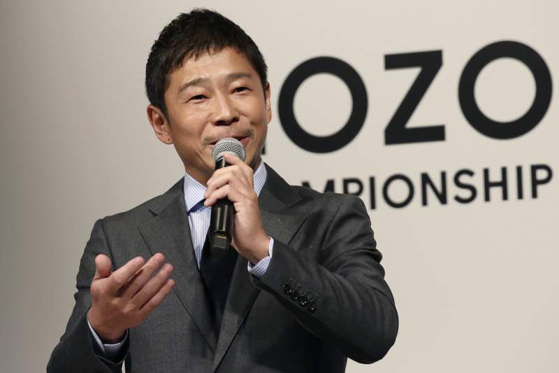 FILE - In this Nov. 20, 2018, file photo, Zozo Chief Executive Yusaku Maezawa speaks during a press conference on the PGA Tour in Tokyo.  The Japanese fashion tycoon who's booked a SpaceX ride to the moon is going to try out the International Space Station first.  Maezawa announced Thursday, May 13, 2021,  that he's bought two seats on a Russian Soyuz capsule. (AP Photo/Koji Sasahara, File)