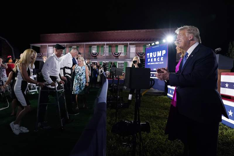 President Donald Trump and first lady Melania Trump greet guests on the third day of the Republican National Convention at Fort McHenry National Monument and Historic Shrine in Baltimore, Wednesday, Aug. 26, 2020. (AP Photo/Andrew Harnik)