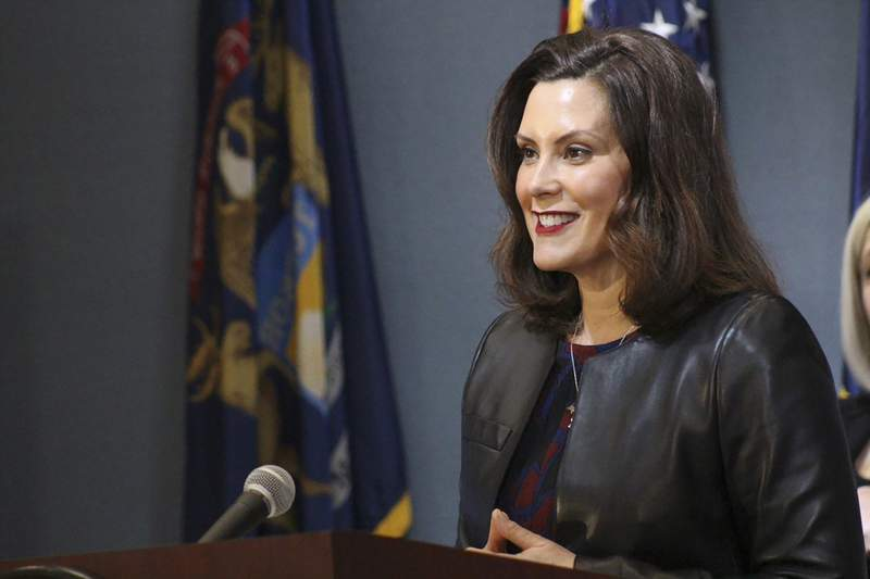In a pool photo provided by the Michigan Office of the Governor, Michigan Gov. Gretchen Whitmer addresses the state during a speech in Lansing, Mich., Friday, May 1, 2020. The governor said Michigan's stay-at-home order remains in effect despite Republicans' refusal to extend her underlying coronavirus emergency declaration, as she amended it to allow construction, real estate and outdoor work to resume next week. (Michigan Office of the Governor via AP, Pool)