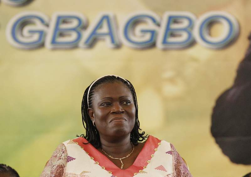 FILE - In this Saturday, Jan. 15, 2011 file photo, Simone Gbagbo, wife of Laurent Gbagbo, smiles during a pro-Gbagbo rally at the Palace of Culture in the Treichville neighborhood of Abidjan, Ivory Coast. In a written ruling issued confidentially on July 19, 2021 and made public this week, the International Criminal Court has withdrawn its arrest warrant for the wife of former Ivory Coast president Laurent Gbagbo following her husband's acquittal on charges of involvement in deadly violence that erupted following his country's disputed 2010 presidential election. (AP Photo/Rebecca Blackwell, File)