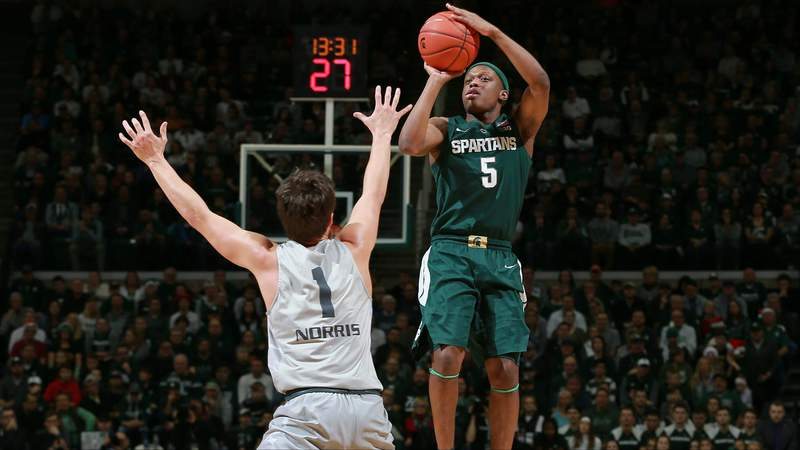 Cassius Winston shoots the ball over Braden Norris of the Oakland Golden Grizzlies at the Breslin Center on Dec. 21, 2018, in East Lansing, Michigan. (Rey Del Rio/Getty Images)