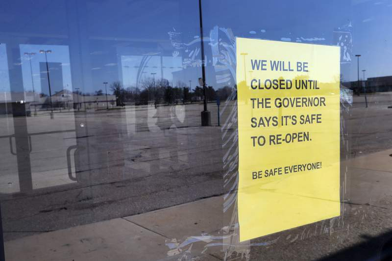 A closed sign is shown at Romeo & Juliet Furniture and Appliances with an empty parking lot in Detroit, Thursday, April 2, 2020. The coronavirus COVID-19 outbreak has triggered a stunning collapse in the U.S. workforce with 10 million people losing their jobs in the past two weeks and economists warn unemployment could reach levels not seen since the Depression, as the economic damage from the crisis piles up around the world. (AP Photo/Paul Sancya)