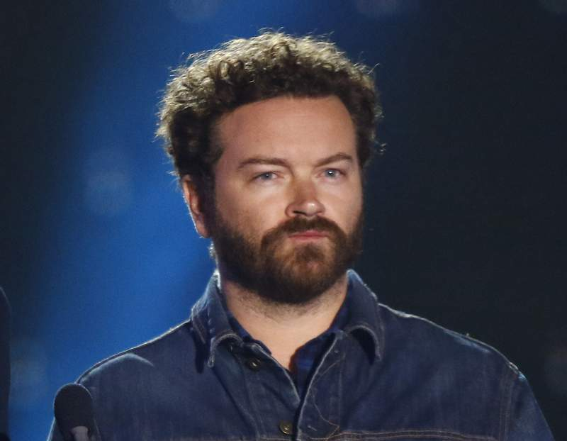 FILE - Danny Masterson appears at the CMT Music Awards in Nashville, Tenn. on June 7, 2017. An attorney for Masterson has pleaded not guilty on his behalf in a Los Angeles court to the rapes of three women in the early 2000s. Attorney Tom Mesereau entered the plea for the 44-year-old actor, who was not in court, to three charges of rape by force or fear. Masterson has been free on bond since his arrest in June. Prosecutors allege that he raped a 23-year-old woman sometime in 2001, a 28-year-old woman in April of 2003, and a 23-year-old woman between October and December of 2003, all at his Hollywood Hills home. (Photo by Wade Payne/Invision/AP, File)