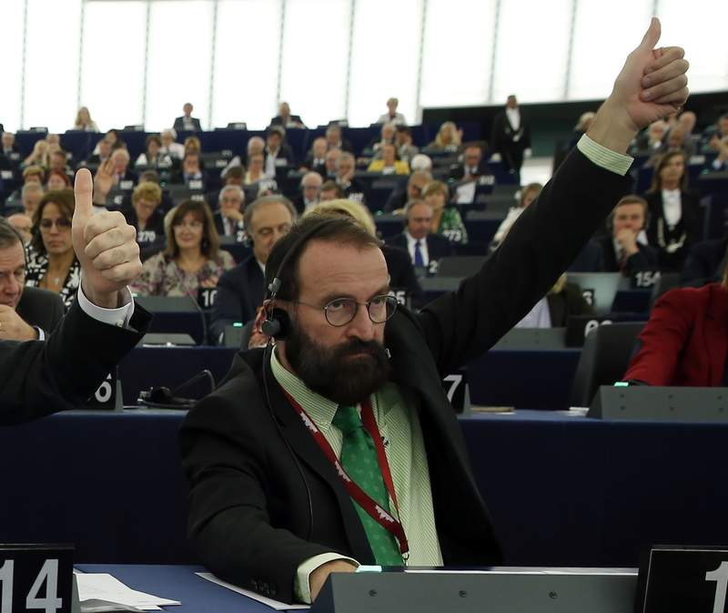 FILE - In this file photo dated Tuesday, Oct. 4, 2016, European lawmaker Jozsef Szajer of Hungary votes during a session at the European Parliament in Strasbourg, eastern France.  Hungarian member of the European Parliament Jozsef Szajer on Tuesday Dec. 1, 2020, admitted to being among those present at an illegal party broken up by Belgian police in central Brussels last week, amid press reports he took part in a COVID-19 lockdown sex orgy. (AP Photo/Jean-Francois Badias, FILE)