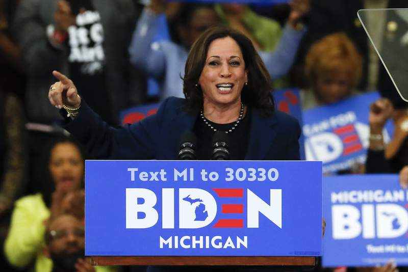 FILE - In this March 9, 2020, file photo, Sen. Kamala Harris, D-Calif., speaks at a campaign rally for Democratic presidential candidate former Vice President Joe Biden at Renaissance High School in Detroit. Before Joe Biden named Harris his running mate, womens groups were readying a campaign of their own: Shutting down sexist coverage and disinformation about a vice presidential nominee they say is headed for months of false smears and brutal attacks from internet haters.  (AP Photo/Paul Sancya, File)