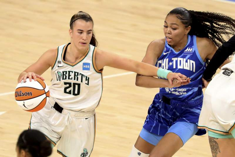 New York Liberty guard Sabrina Ionescu, left, tries to get past Chicago Sky guard Stephanie Watts, right, during a WNBA basketball game Sunday, May 23, 2021, in Chicago. (AP Photo/Eileen T. Meslar)