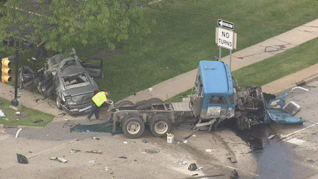 A semi truck and a car were involved in a crash May 28, 2019, at Telegraph and Northline roads in Taylor. (WDIV)