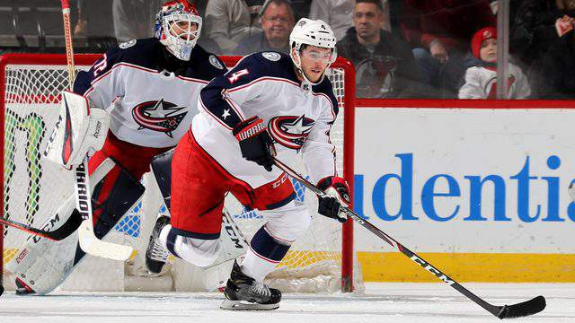 Scott Harrington of the Columbus Blue Jackets takes the puck in the first period against the New Jersey Devils on March 05, 2019 at Prudential Center in Newark, New Jersey. (Photo by Elsa/Getty Images)