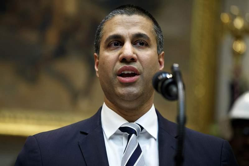 FILE - In this April 12, 2019 file photo, Federal Communications Commission Chairman Ajit Pai speaks during an event in Washington. U.S. phone companies likely broke the law by sharing data that can pinpoint the location of smartphone users, the Federal Communications Commission said Friday, Jan. 31, 20120. FCC Chairman Pai said in a letter to Congress that one or more wireless carriers apparently violated federal law and could be subject to penalties. (AP Photo/Evan Vucci, File)