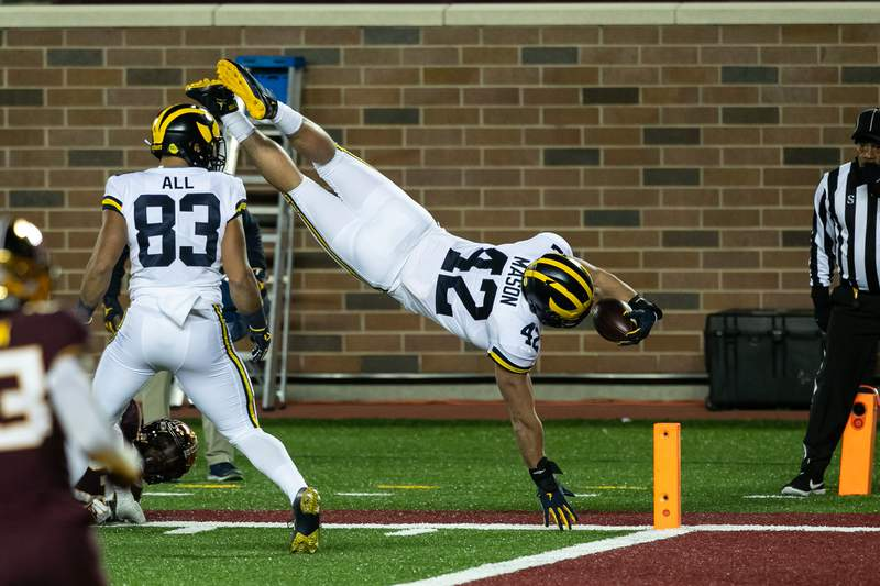 Ben Mason #42 of the Michigan Wolverines dives for the endzone to score a touchdown against the Michigan Wolverines in the first quarter of the game at TCF Bank Stadium on October 24, 2020 in Minneapolis, Minnesota.