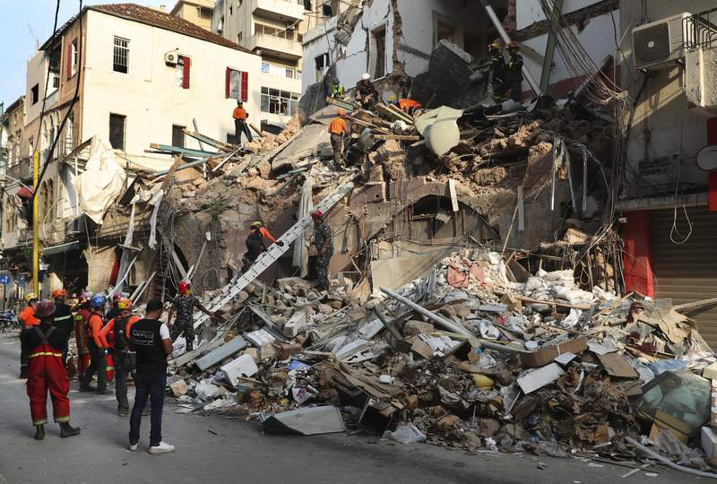 Chilean and Lebanese rescuers search in the rubble of a building that was collapsed in last month's massive explosion, after getting signals there may be a survivor under the rubble, in Beirut, Lebanon, Thursday, Sept. 3, 2020. Hopes were raised after the dog of a Chilean search and rescue team touring Gemmayzeh street, one of the hardest-hit in Beirut, ran toward the collapsed building. (AP Photo/Bilal Hussein)