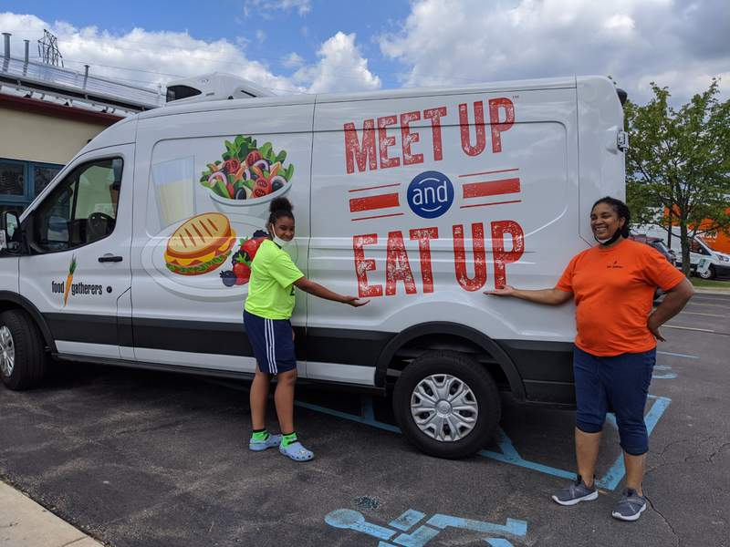 Summer Food Program volunteers pose with a Food Gatherers truck.