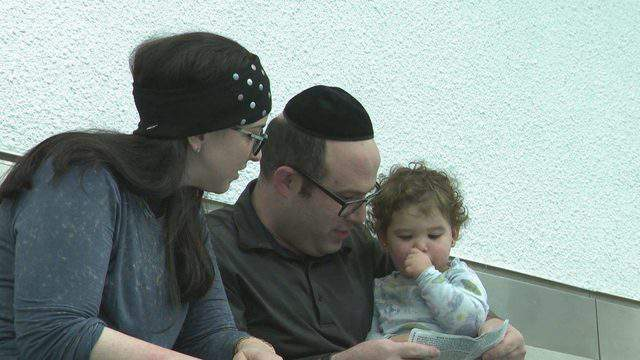 Yossi and Jennie Adler and their 19-month-old daughter were kicked off an American Airlines flight due to body odor, the airline says. (WPLG)