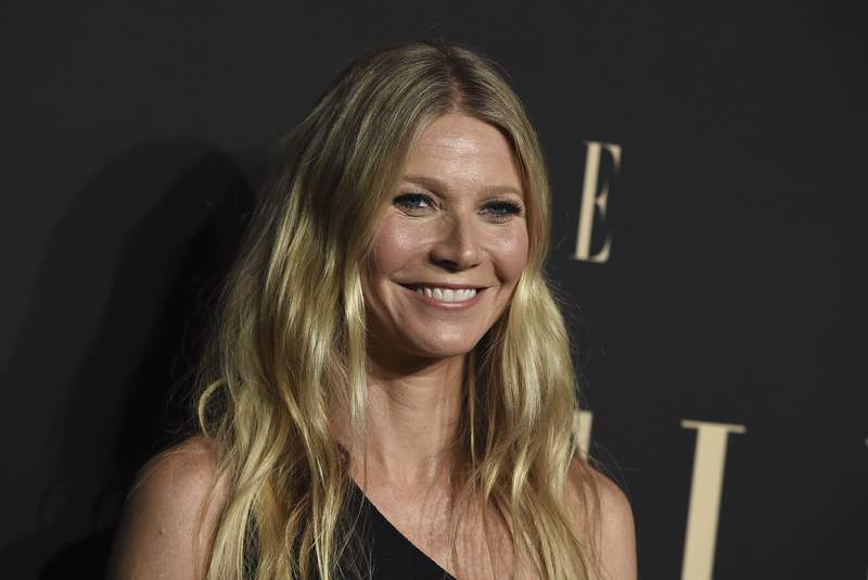FILE - In this Monday, Oct. 14, 2019 file photo, Gwyneth Paltrow arrives at the 26th annual ELLE Women in Hollywood Celebration in Los Angeles. The chief executive of Britain's National Health System on Thursday, Jan. 30, 2020 criticized Gwyneth Paltrow's lifestyle brand Goop and her new Netflix series, warning it carries considerable risks to health. At an event in Oxford this week, Simon Stevens slammed Paltrow's Goop brand for promoting untested treatments like vampire facials and colonic irrigation, noting there is no scientific evidence to suggest they are effective. (Photo by Jordan Strauss/Invision/AP, file)