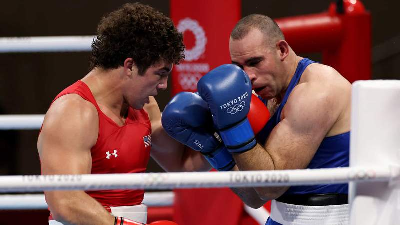 U.S. super heavyweight boxer Richard Torrez Jr. works over Algeria's Chouaib Bouloudinats in Round of 16 action Thursday.