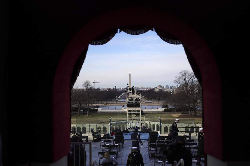 A view from the lower west terrace door as preparations are made prior to a dress rehearsal for the 59th inaugural ceremony for President-elect Joe Biden and Vice President-elect Kamala Harris on Monday, January 18, 2021 at the U.S. Capitol in Washington.  (Win McNamee/Pool via AP)