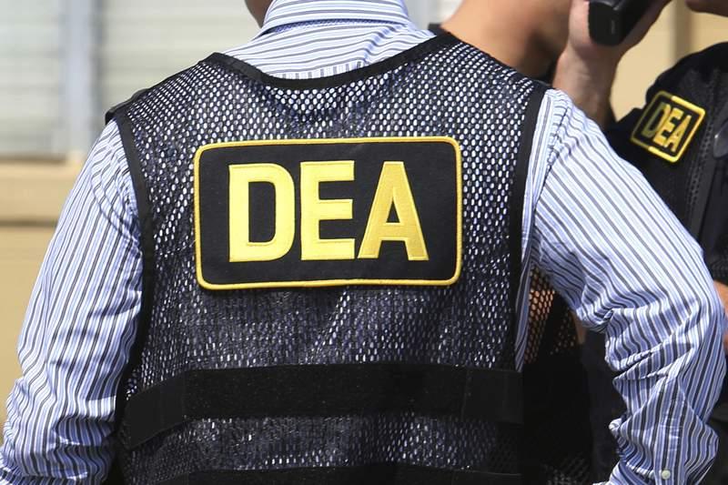 FILE - This June 13, 2016 file photo shows Drug Enforcement Administration (DEA) agents in Florida. (Joe Burbank/Orlando Sentinel via AP, File)