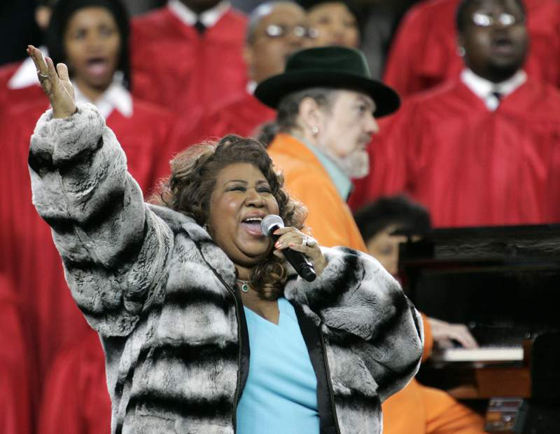 """FILE - In this Feb. 5, 2006 file photo, Aretha Franklin and Dr. John, background on piano, perform the national anthem before the Super Bowl XL football game in Detroit. """"Queen of Soul"""" Franklin and Nobel laureate and """"Beloved"""" author Toni Morrison will be inducted into the National Women's Hall of Fame Thursday, Dec. 10, 2020 as part of a posthumous class of Black honorees that also includes Henrietta Lacks, whose cells were widely used in biomedical research; Barbara Hillary, the first Black woman to travel to both the North and South Pole, and civil rights activists Barbara Rose Johns Powell and Mary Church Terrell. (AP Photo/Gene J. Puskar, File)"""