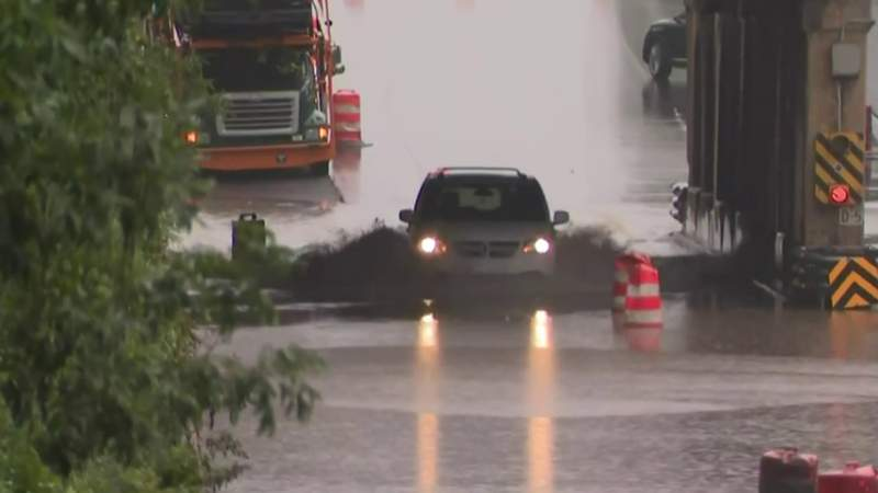 Drivers stall trying to make it through flooded streets