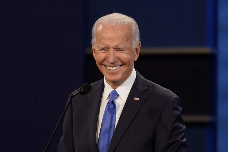 Democratic presidential candidate former Vice President Joe Biden smiling during the second and final presidential debate Thursday, Oct. 22, 2020, at Belmont University in Nashville, Tenn. (AP Photo/Patrick Semansky)