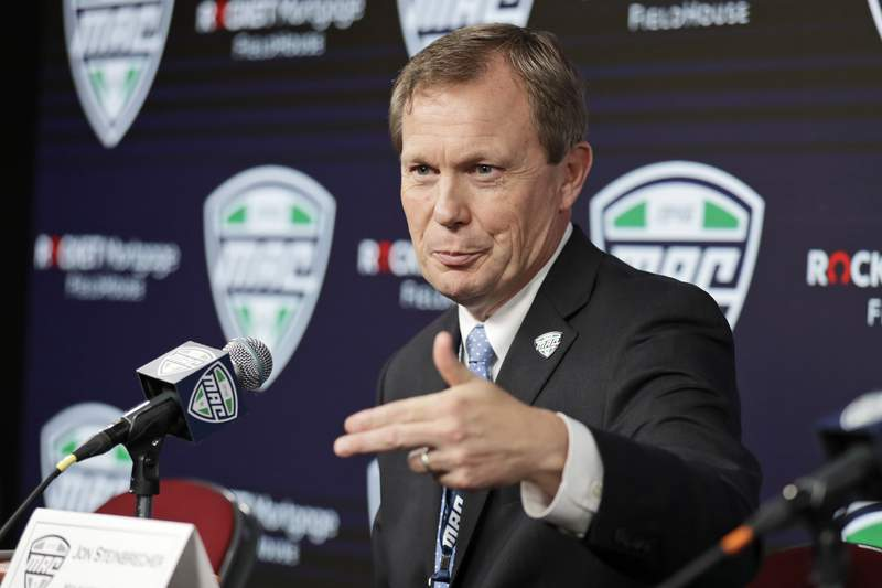 FILE - In this March 12, 2020, file photo, Mid-American Conference commissioner Jon Steinbrecher speaks to the media in Cleveland. The Mid-American Conference on Saturday, Aug. 8, 2020, became the first league competing at college footballs highest level to cancel its fall season because of COVID-19 concerns. With the MACs 12 schools facing a significant financial burden by trying to maintain costly coronavirus protocols, the conferences university presidents made the decision to explore a spring season. (AP Photo/Tony Dejak, File)