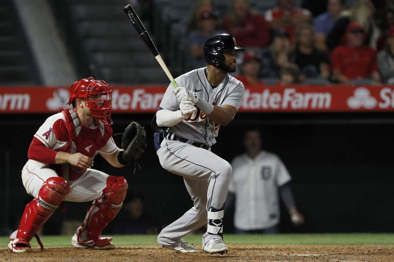 Detroit Tigers' Willi Castro, right, hits an RBI single with Los Angeles Angels catcher Max Stassi, left, watching to score Akil Baddoo during the seventh inning of a baseball game in Anaheim, Calif., Friday, June 18, 2021.