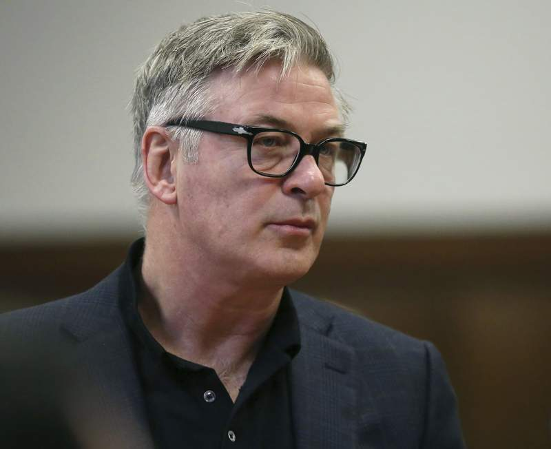 FILE - In this Jan. 23, 2019, file photo, actor Alec Baldwin stands in a New York City court, for a hearing on charges that he slugged a man during a dispute over a parking spot in 2018. Baldwin didn't slander Wojciech Cieszkowski in interviews about a parking dispute that turned physical, a judge has ruled, as dueling lawsuits between the two continue. (Alec Tabac/The Daily News via AP, Pool, File)