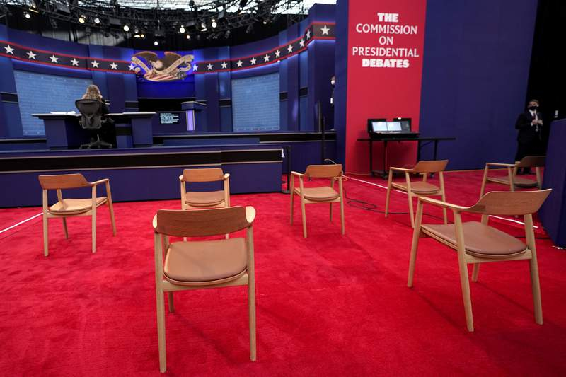 Chairs are seen in social distance spacing ahead of the first presidential debate between Republican candidate President Donald Trump and Democratic candidate former Vice President Joe Biden at the Health Education Campus of Case Western Reserve University, Tuesday, Sept. 29, 2020, in Cleveland. (AP Photo/Julio Cortez)