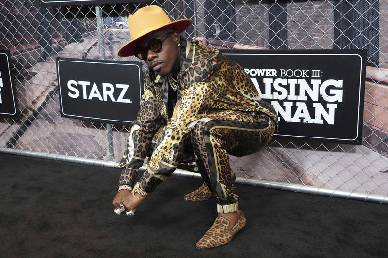 """FILE - DaBaby attends the world premiere of """"Power Book III: Raising Kanan"""" at the Hammerstein Ballroom on Thursday, July 15, 2021, in New York. DaBaby was cut Sunday, Aug. 1, 2021 from Lollapalooza's closing lineup following crude and homophobic remarks he made last week at a Miami-area music festival. (Photo by Charles Sykes/Invision/AP)"""