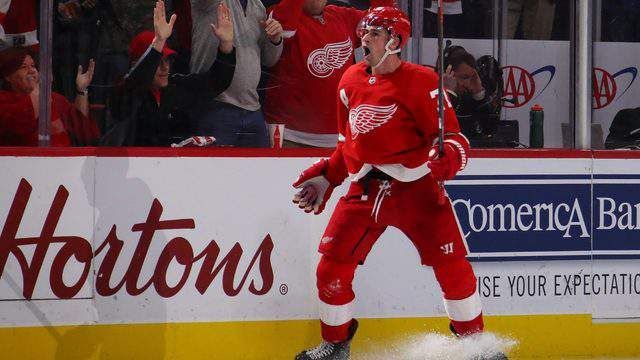 Dylan Larkin of the Detroit Red Wings reacts to his game winning overtime goal to beat the Nashville Predators 4-3 at Little Caesars Arena on January 04, 2019 in Detroit, Michigan. (Photo by Gregory Shamus/Getty Images)