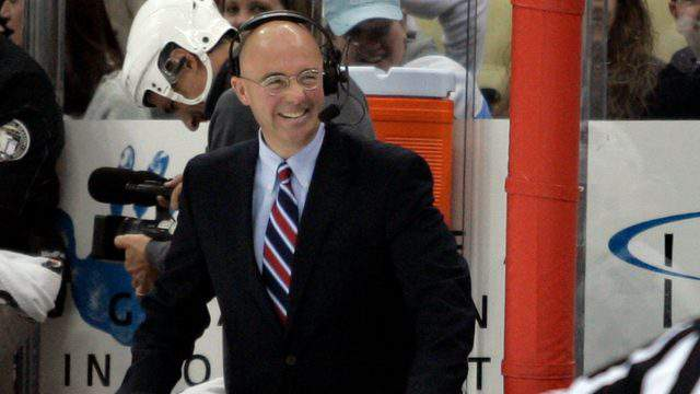 Pierre McGuire laughs after having a close call with a puck during the game between the Pittsburgh Penguins and the Toronto Maple Leafs at Consol Energy Center on December 8, 2010 in Pittsburgh, Pennsylvania. (Photo by Justin K. Aller/Getty Images)