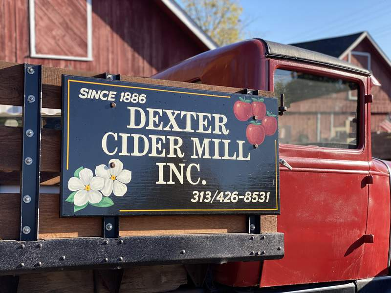 A vintage truck with a sign is parked outside the Dexter Cider Mill on Oct. 16, 2020.