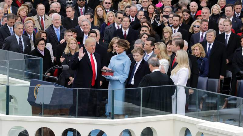 Supreme Court Justice John Roberts (R) administers the oath of office to U.S. President Donald Trump (L) as his wife Melania Trump holds the Bible on the West Front of the U.S. Capitol on January 20, 2017. (Photo by Chip Somodevilla).