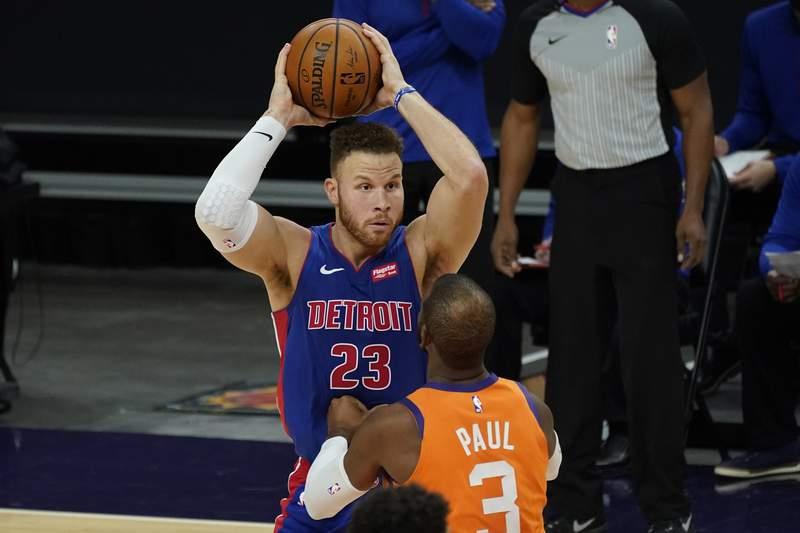 Detroit Pistons forward Blake Griffin (23) looks to pass over Phoenix Suns guard Chris Paul (3) during the first half of an NBA basketball game, Friday, Feb. 5, 2021, in Phoenix. (AP Photo/Matt York)