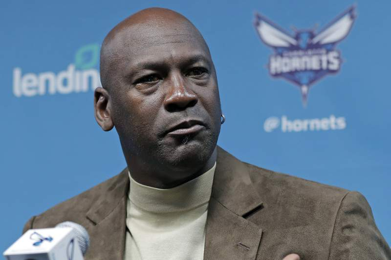 FILE - In this Feb. 12, 2019, file photo, Charlotte Hornets owner Michael Jordan speaks to the media about hosting the NBA All-Star basketball game during a news conference in Charlotte, N.C. Jordan spoke to his Hornets players recently via video conference call about what it takes to be a champion, emphasizing the need for accountability, even if it means making teammates comfortable (AP Photo/Chuck Burton, File)
