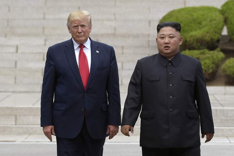 """FILE - In this June 30, 2019, file photo, President Donald Trump, left, meets with North Korean leader Kim Jong Un at the North Korean side of the border at the village of Panmunjom in Demilitarized Zone. Journalist Bob Woodwards book Rage,"""" includes new details about the presidents comments on Kim Jong Un, racial unrest and a mysterious new weapon that Trump says other world powers dont know about. (AP Photo/Susan Walsh, File)"""
