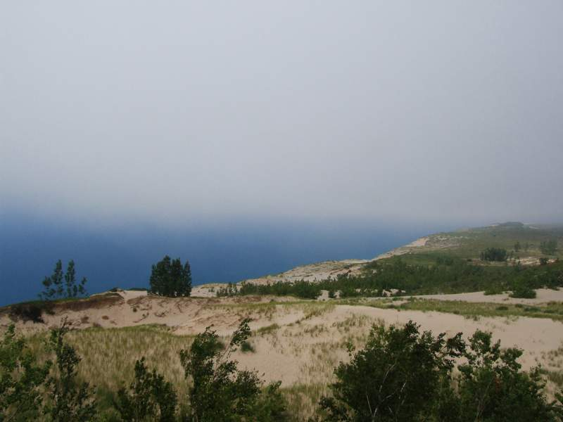 View of a section of Sleeping Bear Dunes National Lakeshore park and fog-obscured Lake Michigan beyond, Michigan, November 2013. (Photo by Interim Archives/Getty Images)