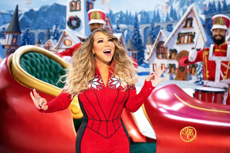 """Mariah Carey performs during her holiday special """"Mariah Carey's Magical Christmas Special"""" on Apple TV+. (Apple TV+ via AP)"""