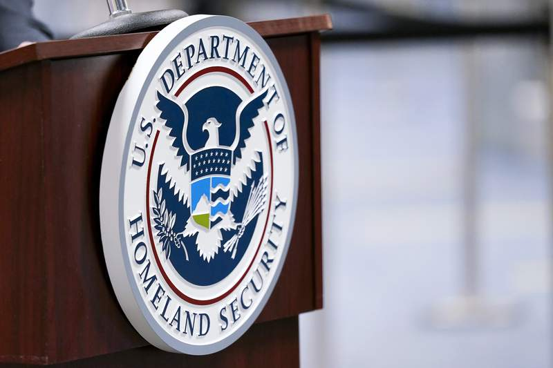 FILE - In this Nov. 20, 2020, file photo a U.S. Department of Homeland Security plaque is displayed a podium as international passengers arrive at Miami international Airport where they are screened by U.S. Customs and Border Protection in Miami. The Department of Homeland Security plans to ramp up its social media tracking as part of an enhanced focus on domestic violent extremism. The move is a response ding to weaknesses exposed by the deadly Capitol insurrection but also raising longstanding concerns about protecting Americans civil liberties. (AP Photo/Lynne Sladky, File)