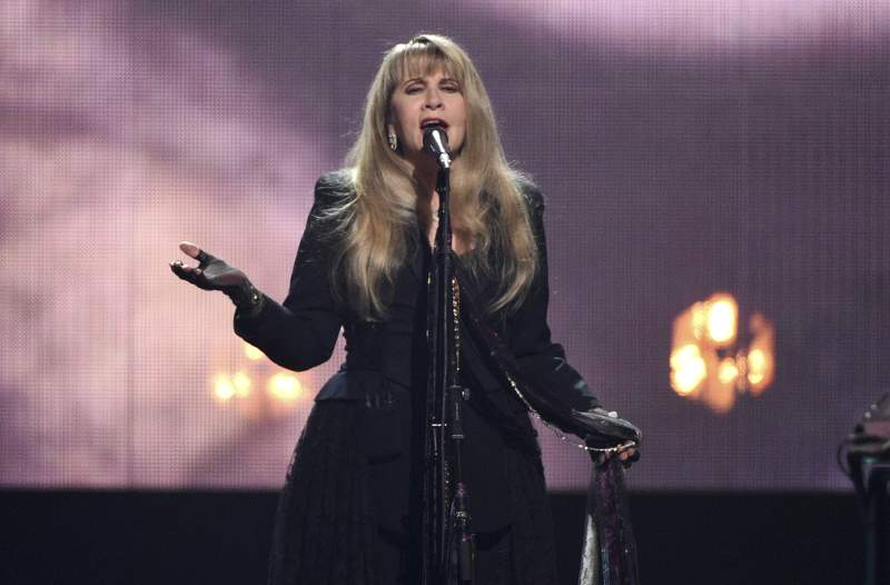 FILE - Inductee Stevie Nicks performs at the Rock & Roll Hall of Fame induction ceremony on March 29, 2019, in New York. Nicks canceled appearances at five music festivals where she had planned performances, citing coronavirus concerns. (Photo by Evan Agostini/Invision/AP, File)