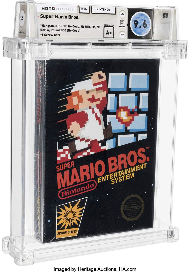 This photo provided by Heritage Auctions, shows an unopened copy of Nintendo's Super Mario Bros., purchased in 1986 and then forgotten about in a desk drawer for decades that has sold for $660,000 at auction. Heritage Auctions in Dallas said thevideo gamesold Friday, April 2, 2021. (Emily Clements/Heritage Auctions via AP)