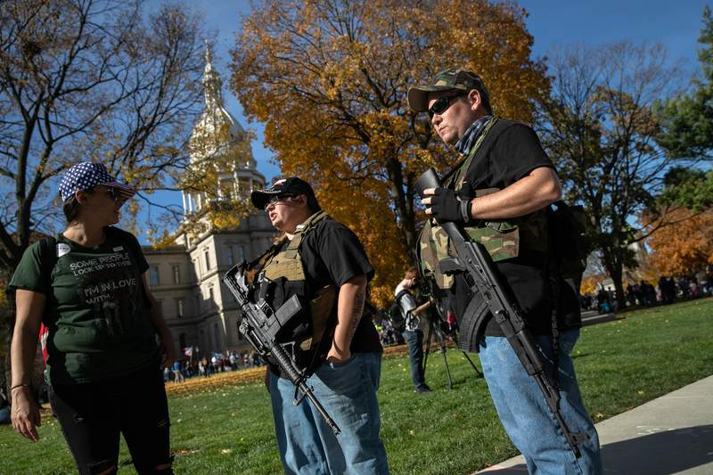 LANSING, MICHIGAN - NOVEMBER 07: Armed Trump supporters take part in a demonstration at the Michigan State Capitol building on November 07, 2020 in Lansing, Michigan. The pro-Trump rally was disrupted when counter-protesters rushed into the event. (Photo by John Moore/Getty Images)
