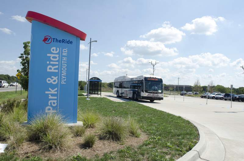 A bus waits at the Park & Ride lot on Plymouth Rd.