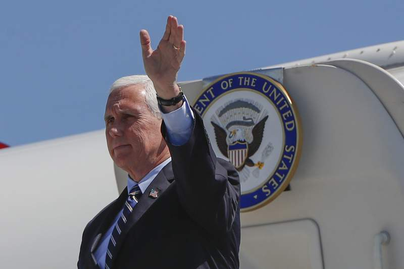 Vice President Mike Pence waves as he arrives at the 171st Air Refueling Wing base, Friday, June 12, 2020, in Imperial, Pa. (AP Photo/Keith Srakocic)