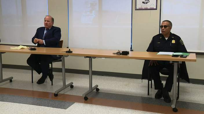 Detroit Mayor Mike Duggan and Police Chief James Craig speak at a COVID-19 news conference on March 25, 2020. They sat at a distance from each other.