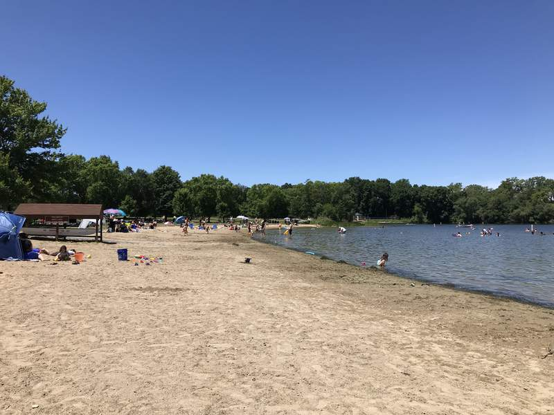 People swim at Independence Lake beach on July 14, 2019.