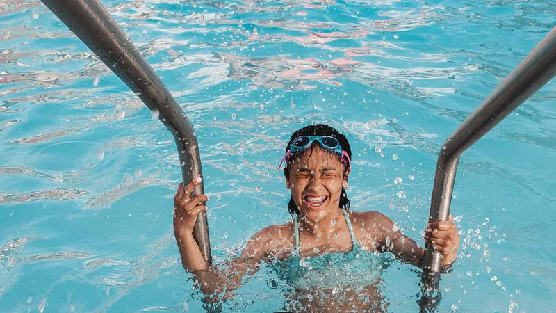 A child swimming in a pool.