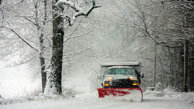 A snow plow clears the road of snow December 9, 2005 near Lincoln, Massachusetts. The fast moving storm, shut down some schools and snarled traffic on its way to dumping up to seven inches of snow across the Northeast.