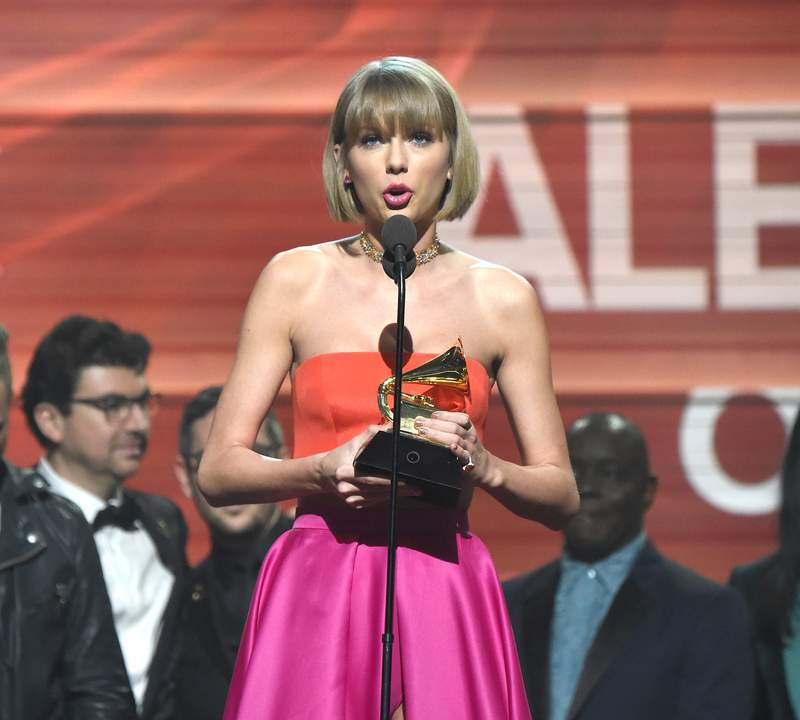 Taylor Swift accepts award onstage during The 58th GRAMMY Awards at Staples Center on February 15, 2016 in Los Angeles, California. (Photo by Kevin Mazur/WireImage)